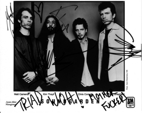 Soundgarden autographed this picture for us at Triad Studios